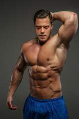 Muscular guy posing in studio