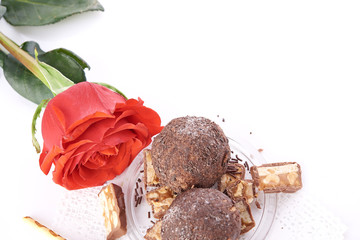 Cupcake with chocolate on wooden background
