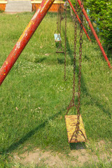 the old metal Swing in Playground under sunlight