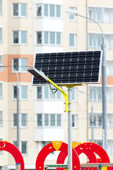Street lamp powered by solar batteries