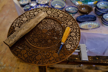 Wooden plate with patterns made by hand