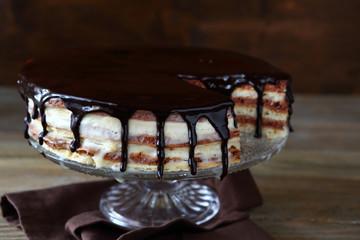Chocolate layered cake on glass stand