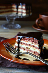 Piece of rustic cake with chocolate icing