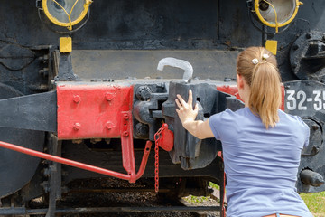 Woman trying to stop the train