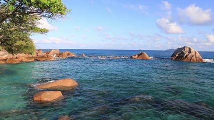 Beautiful granite boulders in Indian Ocean on the beach of Anse