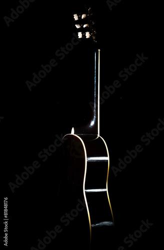 Staande foto Muziekwinkel Detail of an acoustic guitar with a shallow
