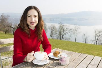 Woman having breakfast in a restaurant