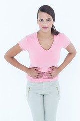 Woman with stomach pain looking at camera