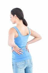 Pretty brunette suffering from back pain