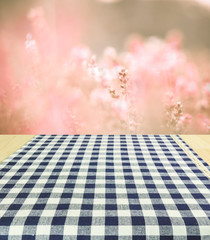 Empty wooden and tablecloth with nature background.