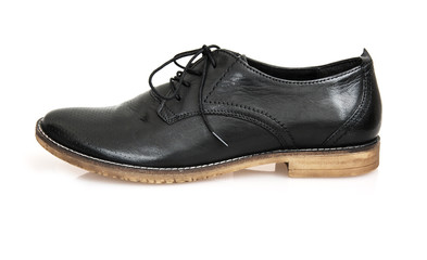One new black leather shoe