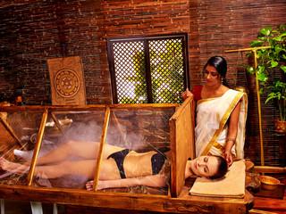 Woman having Ayurveda sauna.