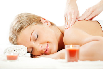 Young woman having neck massage on spa treatment
