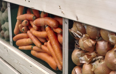 bunch of freshly harvested potatoes in a wooden box and some
