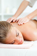 Leinwanddruck Bild - Young woman having back massage on spa treatment