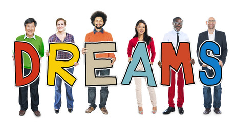 Diverse People Holding Text Dreams Concept
