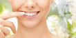 Leinwanddruck Bild - close up of smiling woman face pointing to teeth