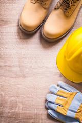 organized copyspace working boots helmet gloves On Wooden Board