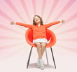 happy little girl sitting on designer chair