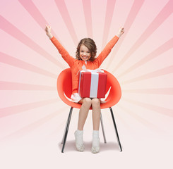happy little girl with gift boxes sitting on chair