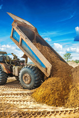 tipper unloadding sand from scoop