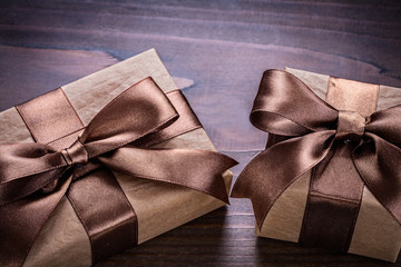 two vintage paper gift boxes on old wooden board