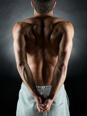 young male bodybuilder from back