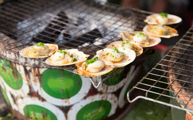 oysters or seafood grill at asian street market