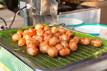 fried meatballs sale at street market