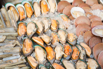 oysters or seafood on ice at asian street market