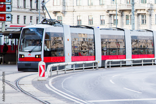 Modern red tram in Vienna Austria.