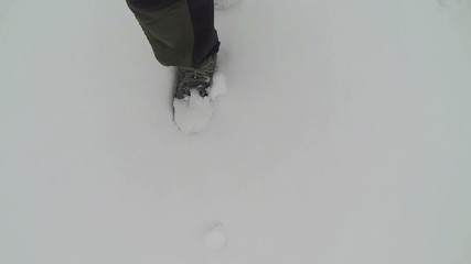 Feet of  man go on snow  winter, Slow motion