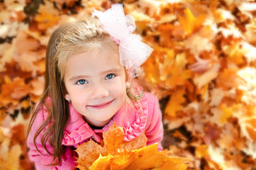 Autumn portrait of adorable little girl