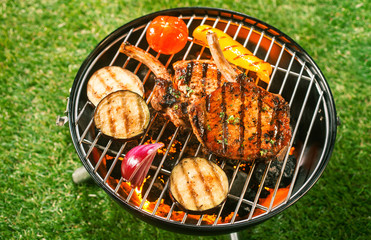 Pork loin and vegetables on a barbecue