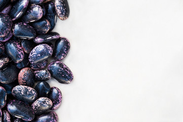 Purple beans on white background close up