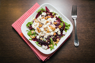 beet salad with arugula, feta and walnut