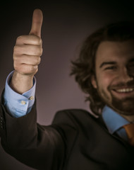 Happy Young Businessman Showing Thumbs Up Sign