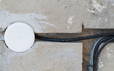 electric wire cables in cement wall