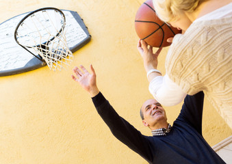 Elderly people playing with ball