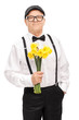 Fashionable senior holding a bunch of yellow tulips