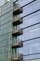 Glass Balconies in Green Glass Office Tower