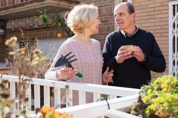 Elderly cuople talking at balcon