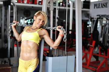 Young sports woman with heavy chain