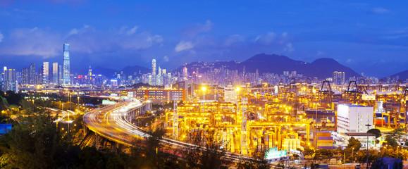 Panorama of cargo terminal and Hong Kong cityscape