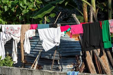 dress driying outside poor hovel, shanty, shack