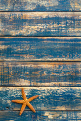 Wooden background with starfish