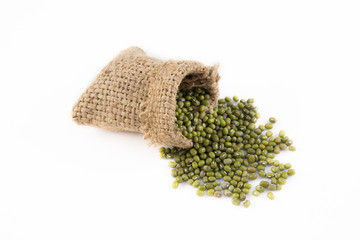 green mung bean in sack with white background