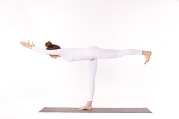Woman practicing yoga in studio