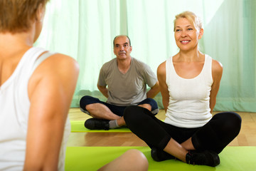 Yoga instructor with elderly attenders