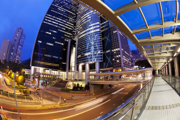 Fisheye view of city at night with traffic trails